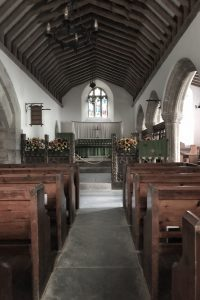 Church interior, Church of St Enodoc, a pretty church with a stone tower in the middle of a gold course, North Cornwall, England