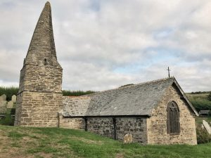 Church of St Enodoc, a pretty church with a stone tower in the middle of a gold course, North Cornwall, England