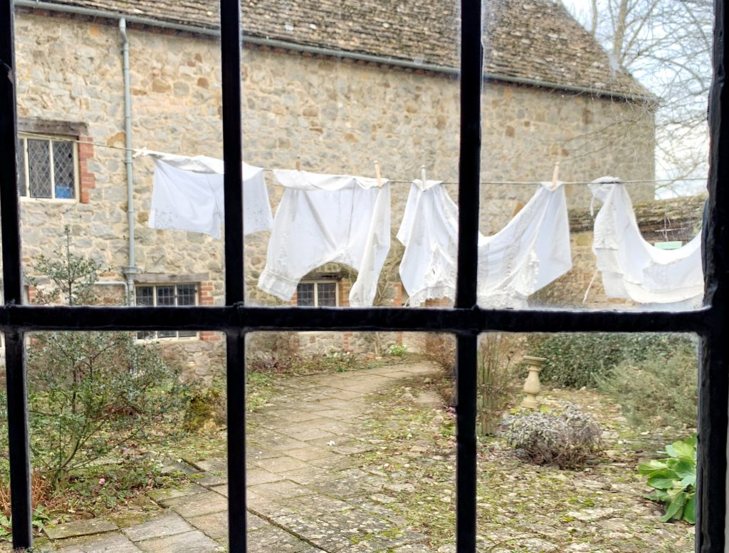 Washing in the Courtyard, seen through the window of the Kitchen at Avebury Manor