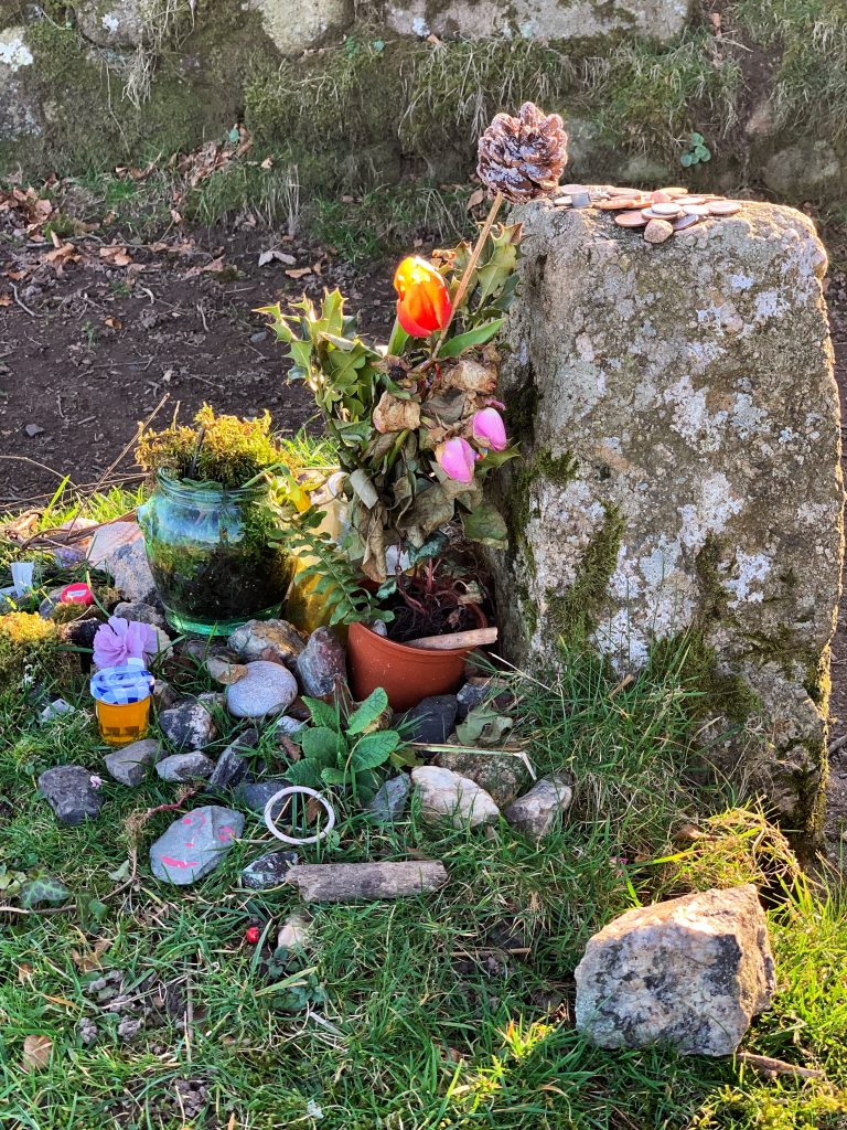 Flowers, votives and offerings on Jay's Grave, Kitty Jay, Dartmoor, Devon