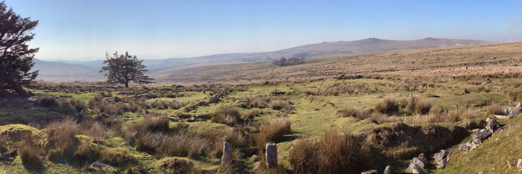 Panoramic view of the ruined 'red cottages' near the disused Foggintor Quarry, close to Merrivale on Dartmoor, Devon