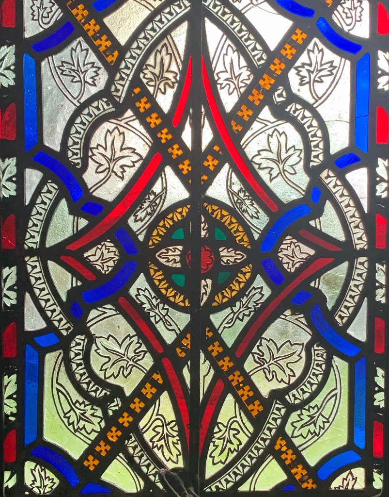 Detail of a geometric stained glass window by the Whitechapel glass works at the Church of St Mary the Virgin, Compton Pauncefoot, Somerset