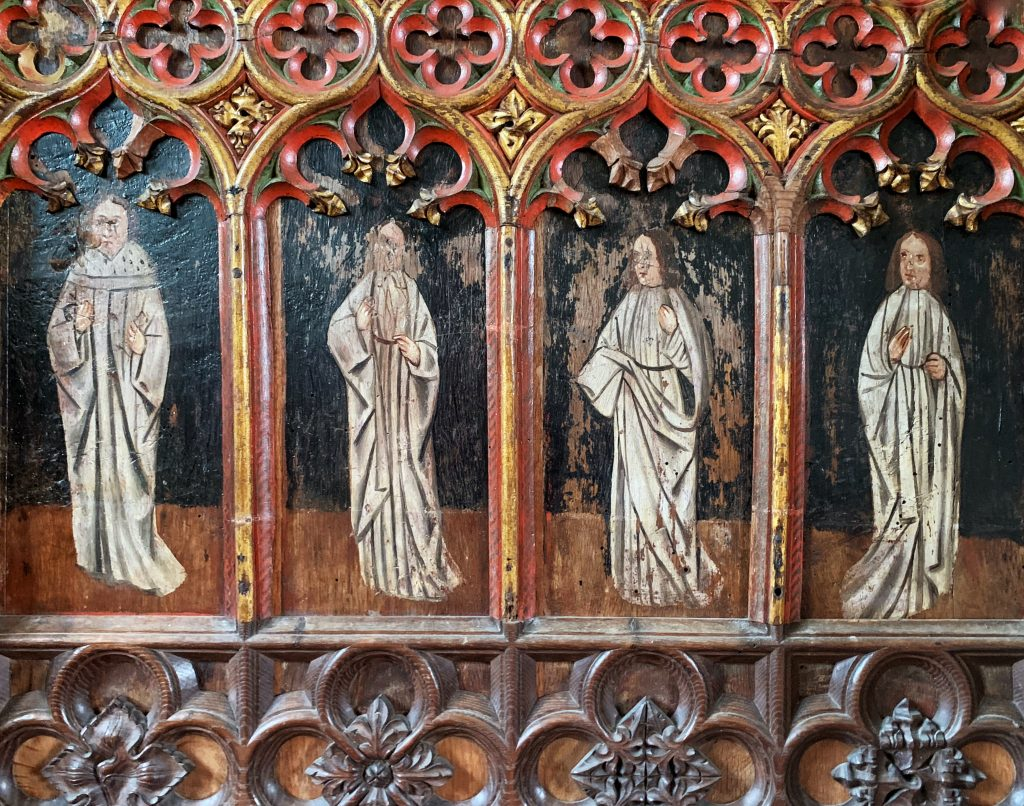 Detail of four saints from the Rood Screen at the Church of All Saints, South Milton, the South Hams, Devon