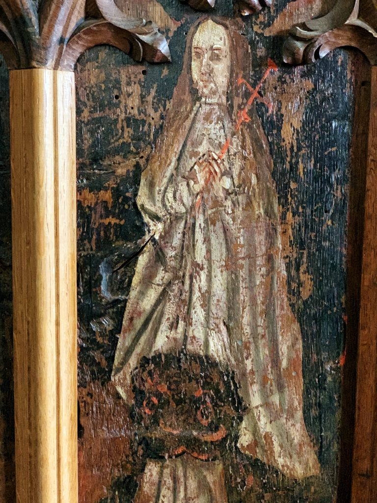 Detail of a Saint on the Rood Screen at the Church of All Saints, South Milton, the South Hams, Devon