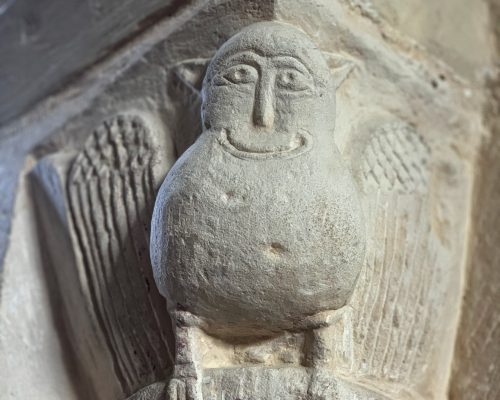 Detail of a stone carving from the Chancel Archway at the Church of St Andrew, Great Durnford, Wiltshire