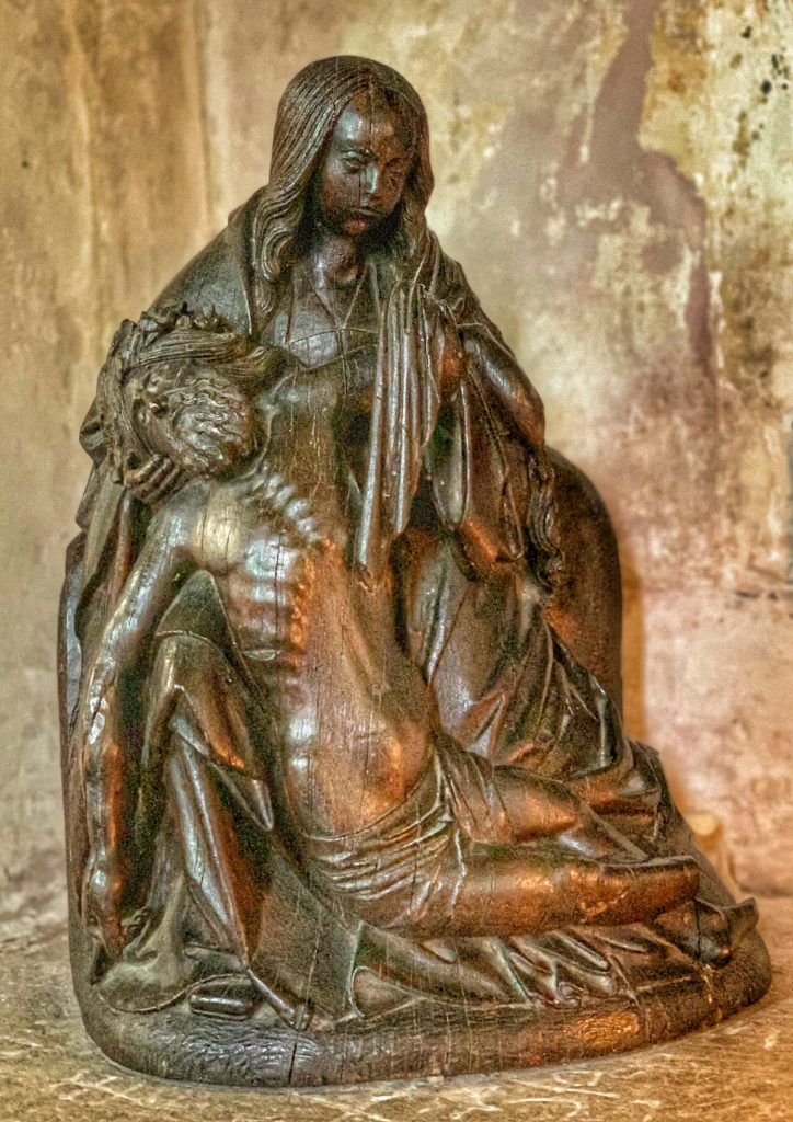 16th century Flemish oak sculpture of the Pieta at the Church of St Andrew, Great Durnford, Wiltshire