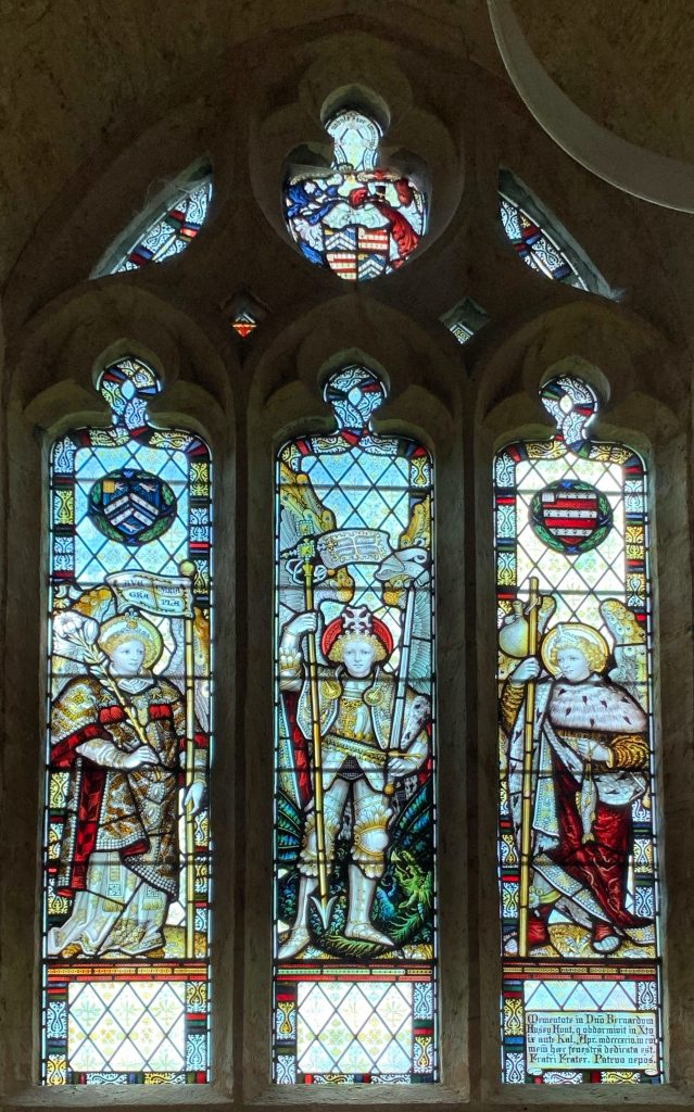 Stained glass window of the Archangels Gabriel, Michael and Raphael in the church of St Mary the Virgin at Compton Pauncefoot, Somerset