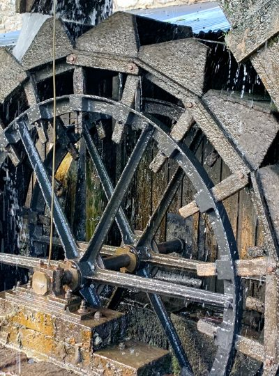 View of the Waterwheel at Finch Foundry, in the village of Sticklepath on Dartmoor, Devon