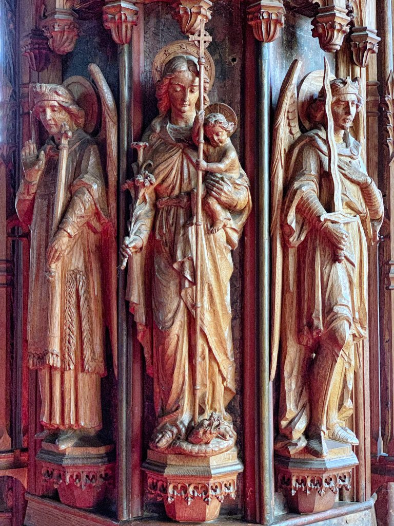 Details of carved figures by Harry Hems on the Restored Rood Screen at the Church of St Andrew, Kenn, near Exeter, Devon