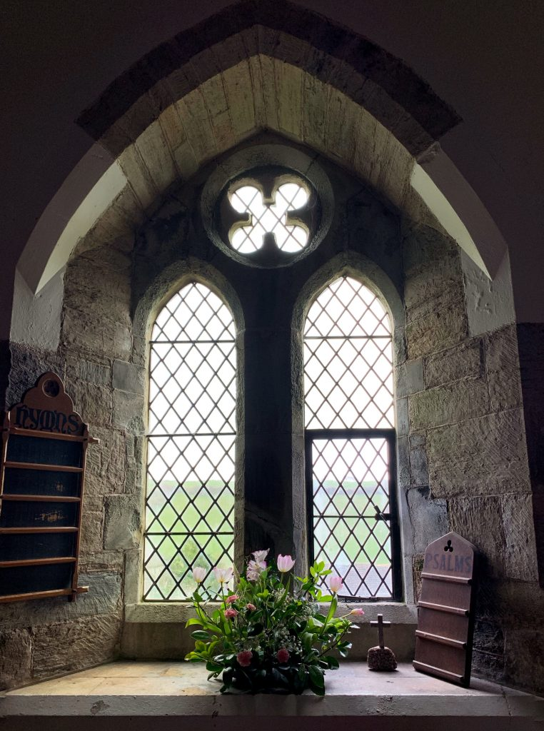Window at the Church of the Holy Trinity at Galmpton, South Hams, Devon