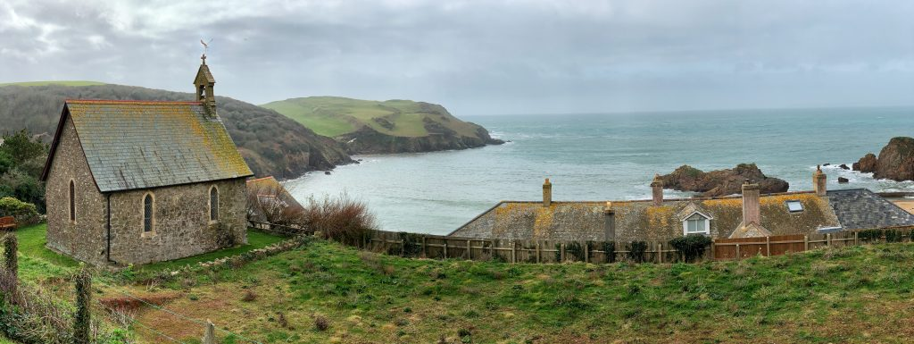 Panoramic view of Hope Cove including St Clement's Chapel, the Colonial House and Bolt Head