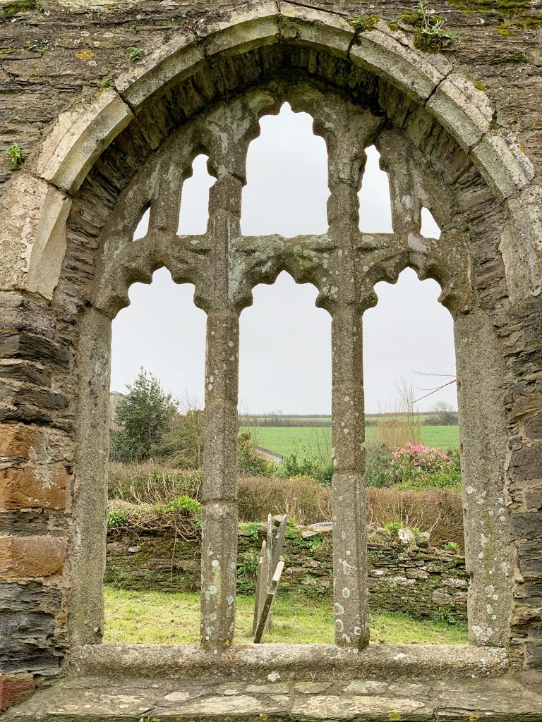 View of window at the ruined church of South Huish, South Hams, Devon