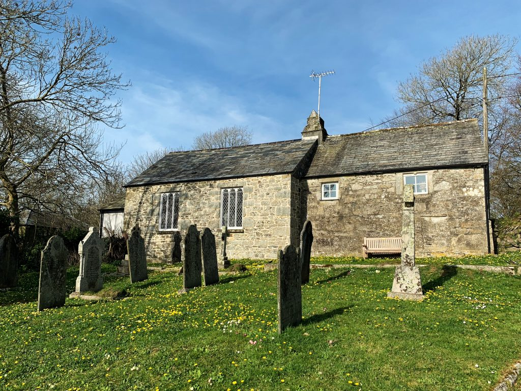 View of Churchgate Cottage and The Old School from St Protus and St Hyacinth Church Graveyard at Blisland, Bodmin Moor, Cornwall