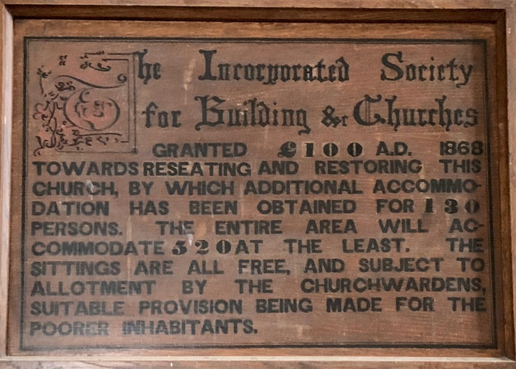 Plaque referring to the renovation of the Church of All Saints in 1868 at Malborough, South Hams, Devon