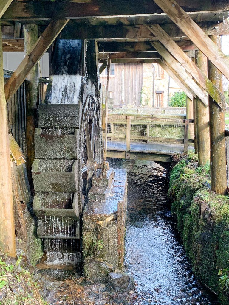 Waterwheel at the National Trust property Finch Foundry, at Sticklepath on Dartmoor, Devon