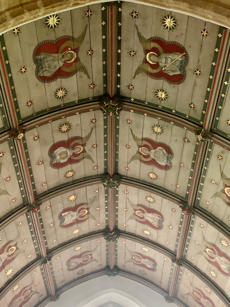 View of the ceiling in the chancel depicting angels holding symbols of the Last Supper and the Passion at the Church of St Mary the Virgin., Compton Pauncefoot, Somerset