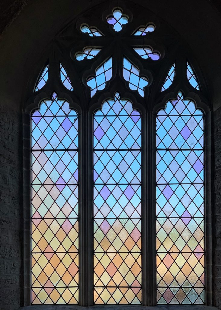 Coloured stained glass window at St Martin's Church, Sherford, the South Hams, Devon