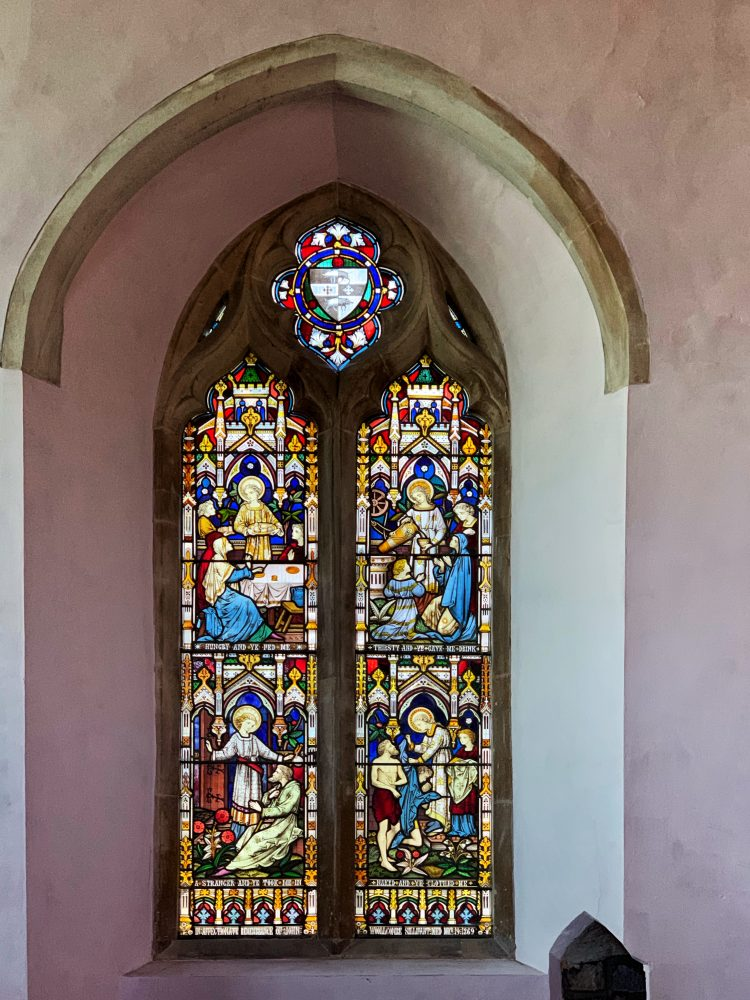 19th century stained glass window at the Church of St Andrew in Colebrooke village, mid-Devon