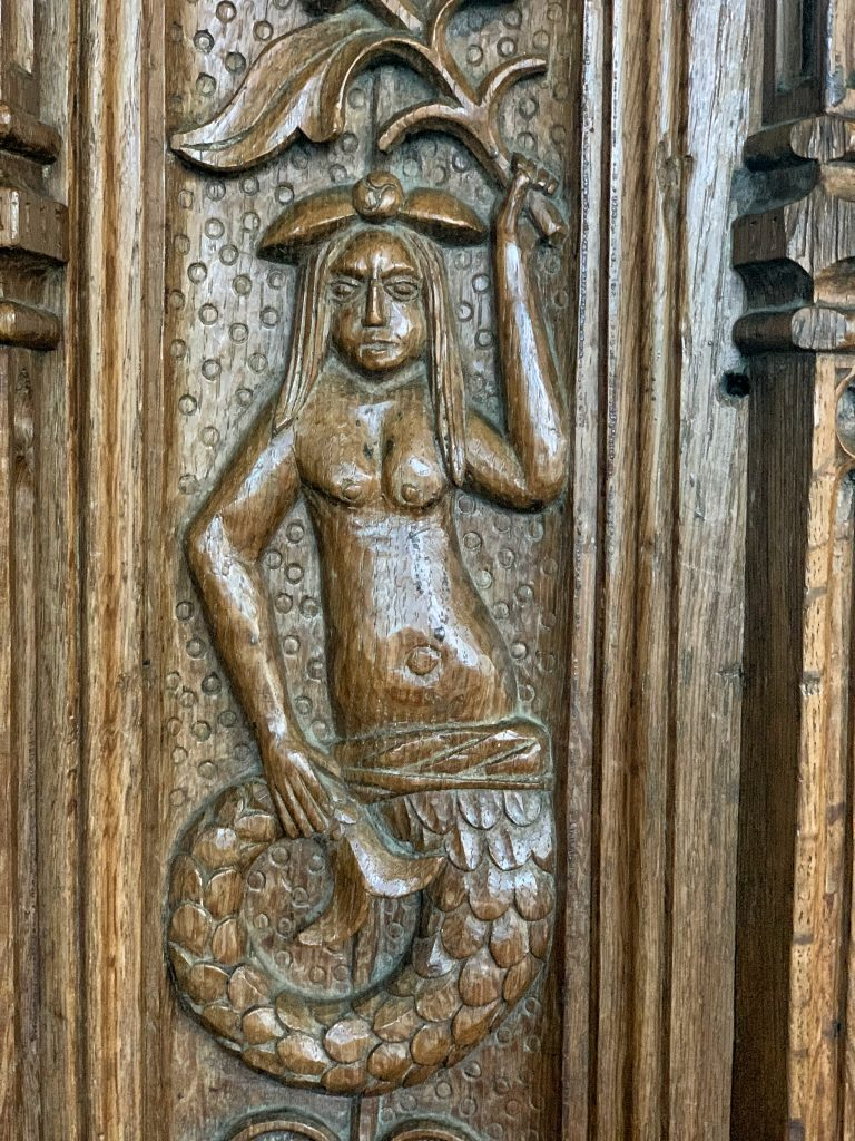 Carved Mermaid on the 16th century pulpit at the Church of St Mary the Virgin, Cheriton Bishop