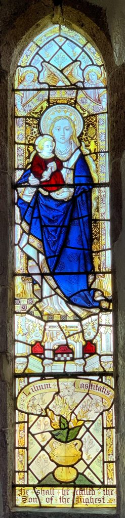 Stained glass window of the Virgin and Child at the Church of St Mary the Virgin, Cheriton Bishop, Devon