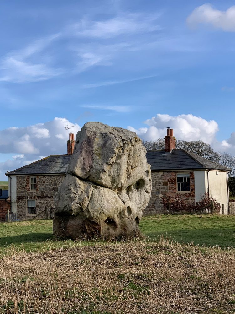 Stone in front of cottages at Avebury, Wiltshire