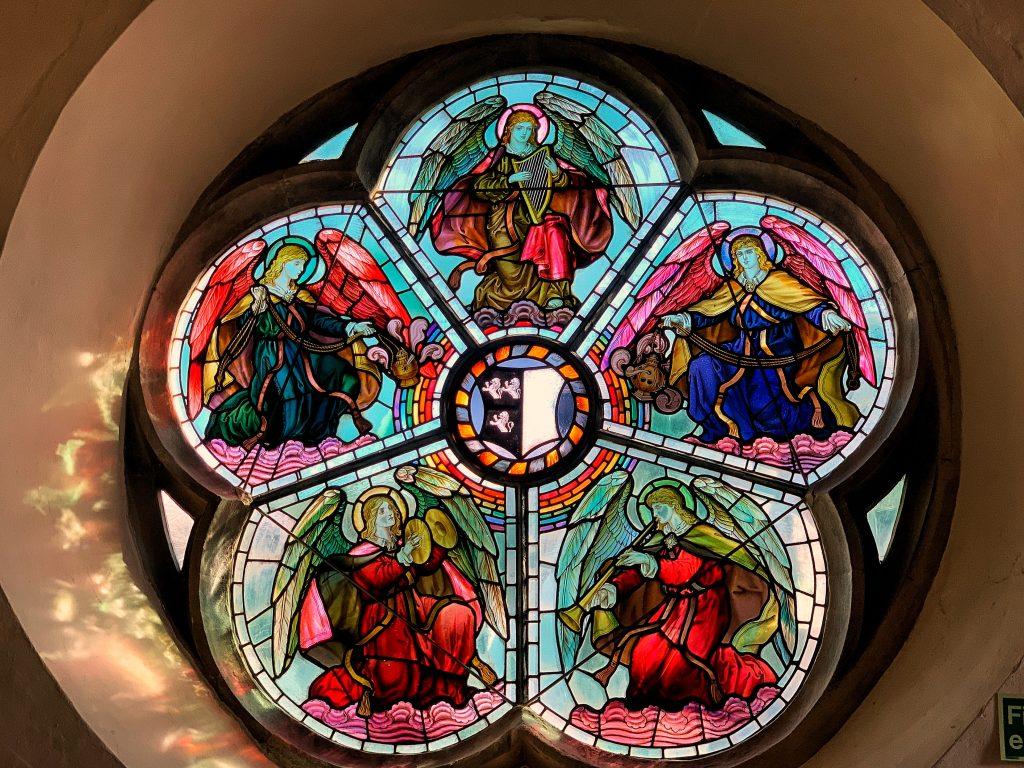 A rose window in the Church of St Saviour in Dartmouth, Devon