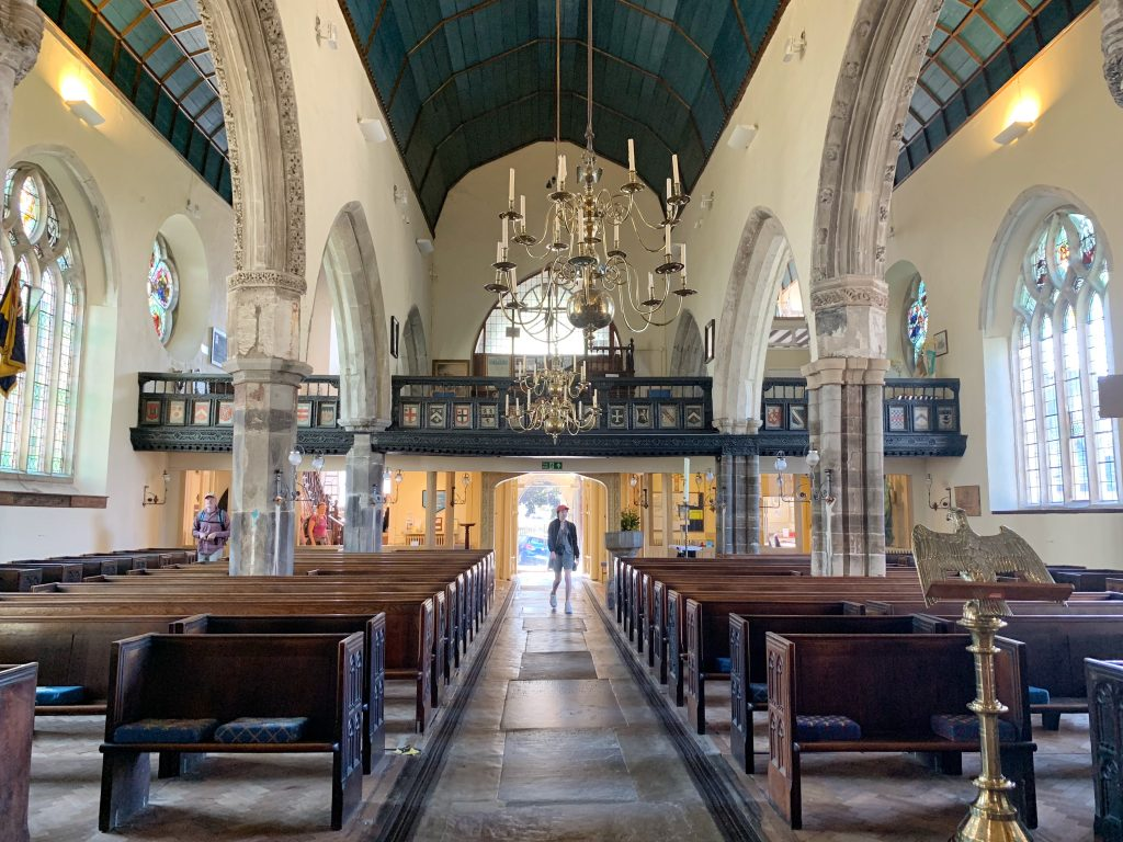 Interior view of the gallery and ancient brass chandeliers at St. Saviour's Church in Dartmouth