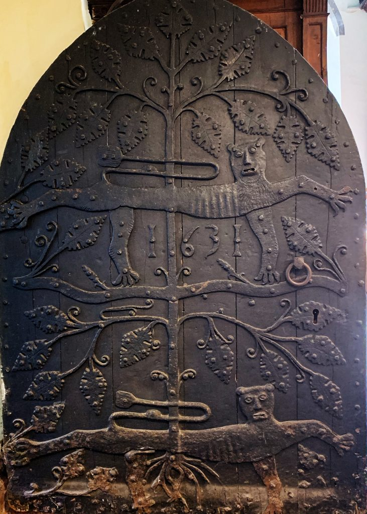 Ancient Carved Door at St. Saviour's church in Devon showing the two leopards, the symbol of the Plantagenets