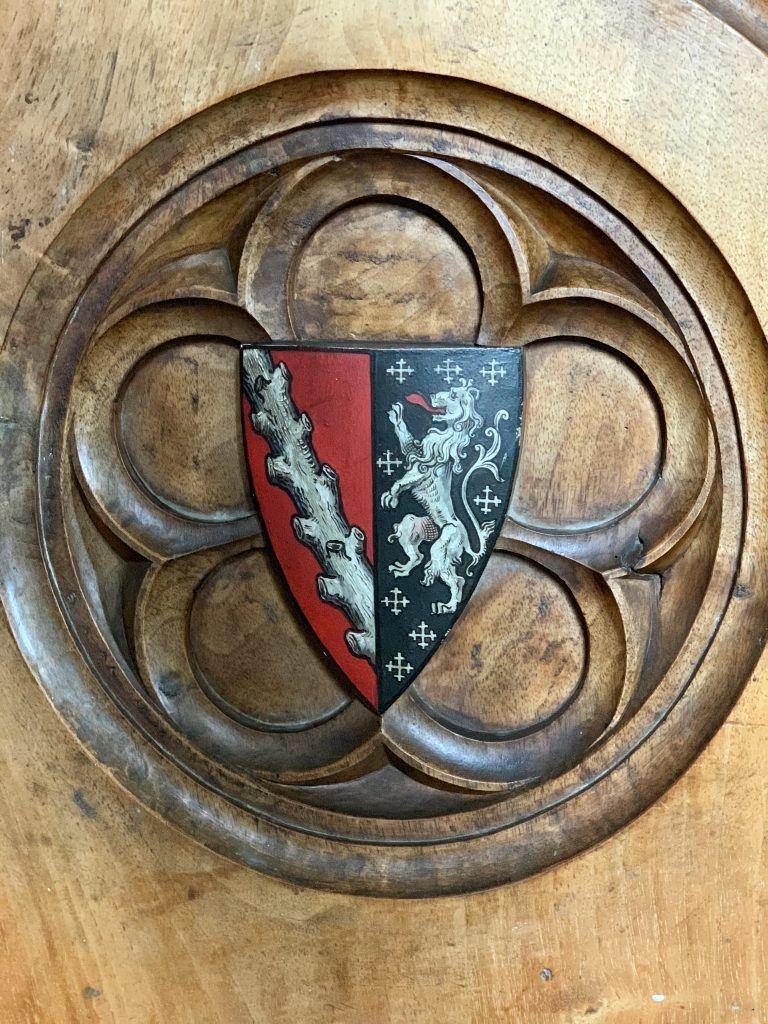 Armorial decoration on pew end in Compton Chamberlayne church, Wiltshire
