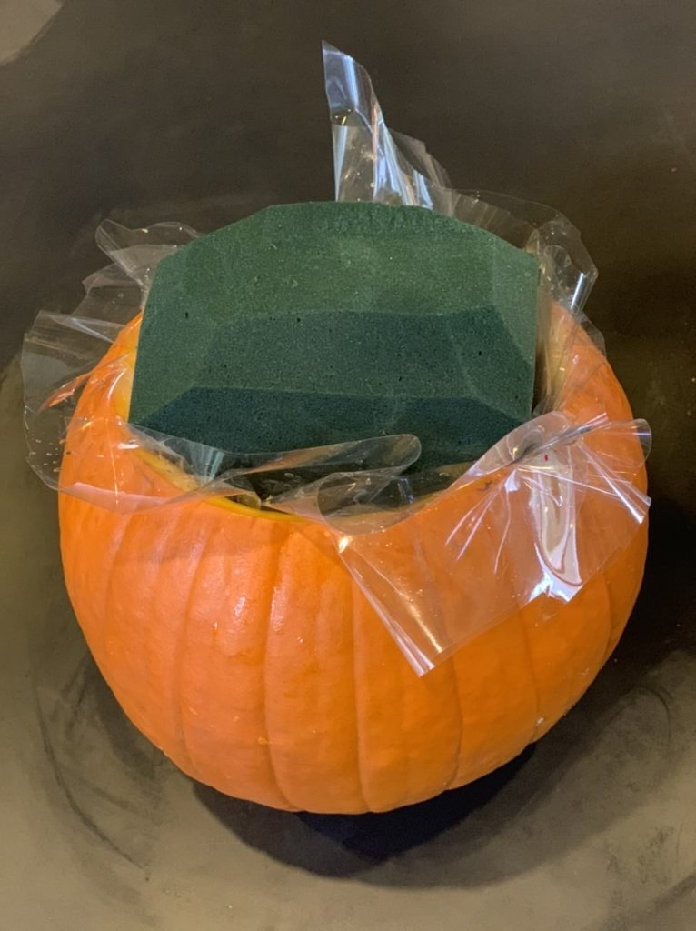 Pumpkin filled with oasis and cellophane